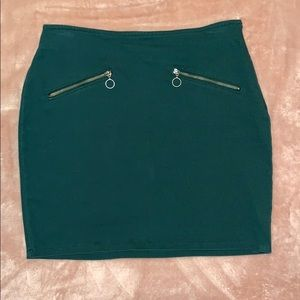 Green mini skirt with cute zippers!